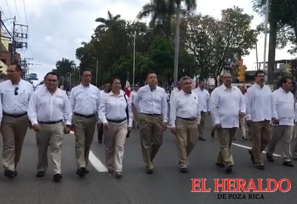 Confirman obreros participación en desfile