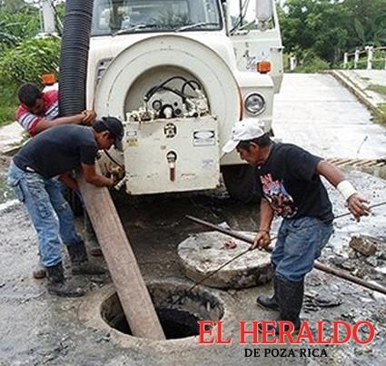 Redoblan limpieza de drenajes